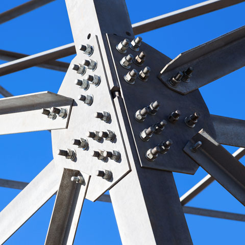 Steel beams against the blue sky. Fragment metal framework.